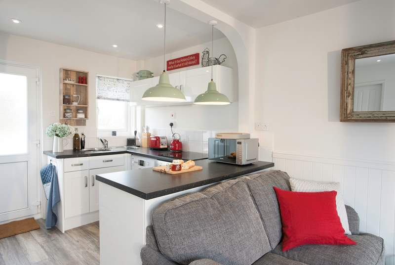 There is a contemporary kitchen which is well-equipped so you can make all your tasty meals whilst on holiday, just bring your favourite food!