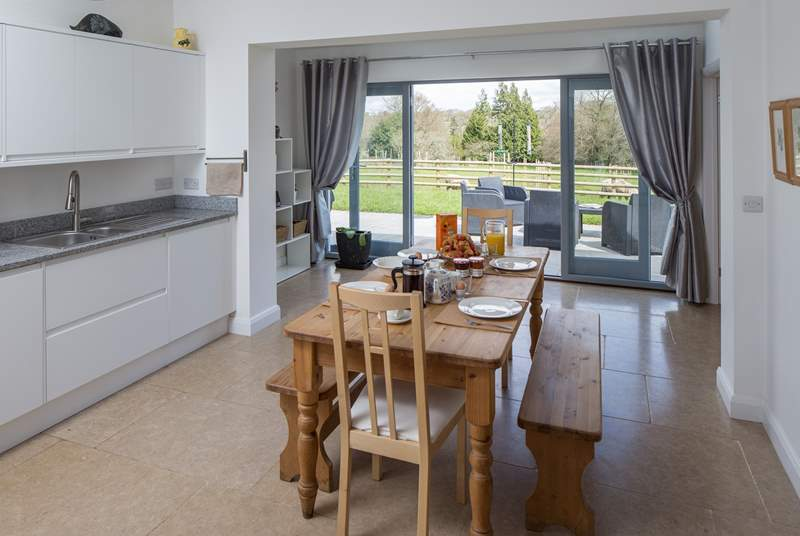 Step out of the kitchen-area, straight onto the beautiful patio, and prepare to be greeted by the most stunning surroundings.