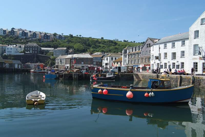 Fishing boats land their catches at the quay.