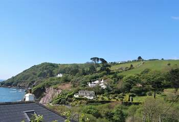 The coastal footpath can just be seen climbing up the hill, where it turns back onto the clifftop at the top.