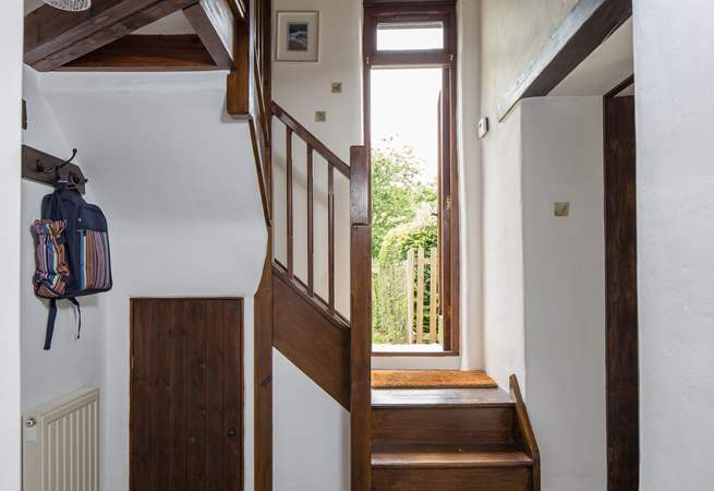 Step through this door into your fully enclosed, lovingly maintained garden.