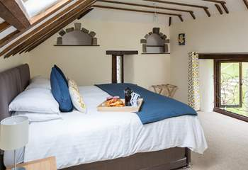 The master bedroom boasts delightful features from the original linhay days.