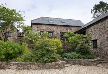 Laurel Cottage through the beautiful greenery.