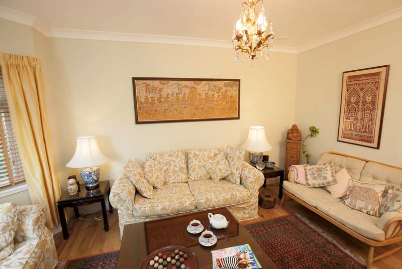 Sit down, feet up and relax in the quiet cosy sitting-room overlooking the Green.