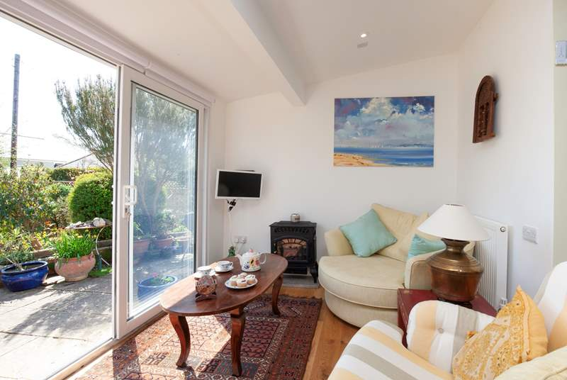 Just a few steps down from the kitchen takes you to this lovely snug area overlooking the garden.