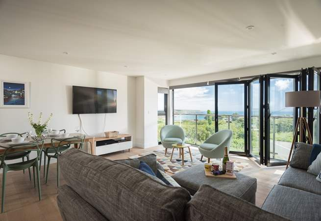 The apartment has a large corner sofa to relax on whilst watching a movie on the Smart TV.