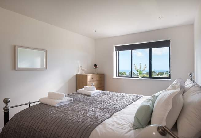 The main bedroom also shares those wonderful sea views and has an en suite shower-room.