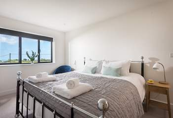 The gorgeous king-size bed with fresh cotton sheets and white fluffy towels awaits you.