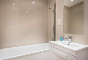 The family bathroom is located opposite bedroom 2.