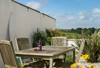 In the shared courtyard there is a table and chairs, bench seat and washing line for guests' use.