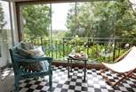 At the back of the house is the mediterranean style sun-room, with lovely views to the back garden and fields beyond.