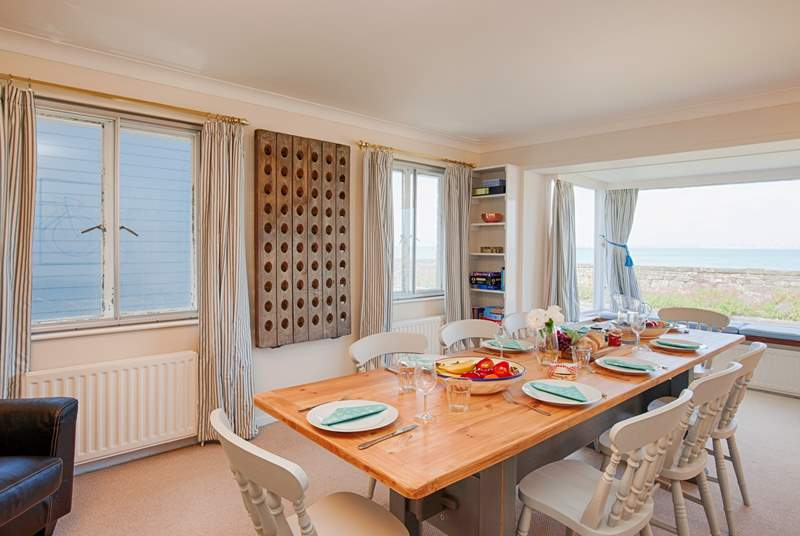 With seating for twelve around the dining-room table, get everybody together to talk about the lovely day you have had exploring the Isle of Wight.