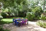 The lovely garden with seating for eight.