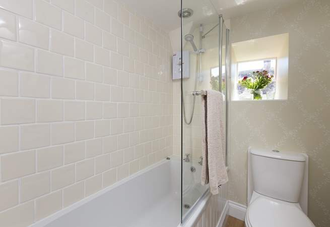 This is the bathroom with fitted shower over the bath. There is a separate WC downstairs too.