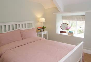 This is the main bedroom with its king-size bed and pretty views to the front of the cottage