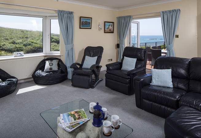 Huge sitting-room opens out onto the decked area. Perfect for those large family/group occasions.