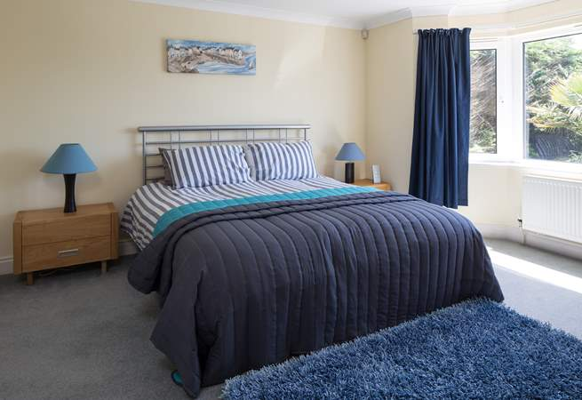 Master bedroom boasts a super inviting super-king size bed. This bedroom is on the ground floor.