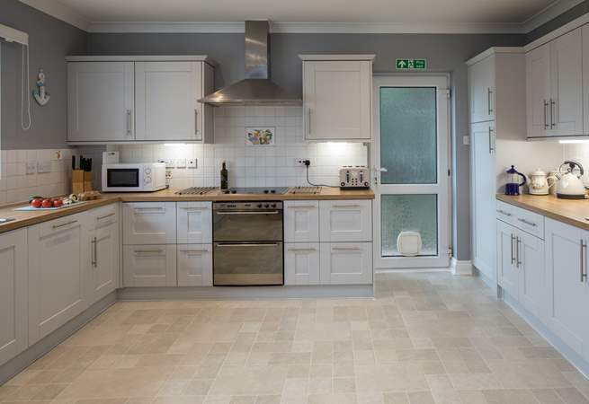 Spacious and well-equipped kitchen, which leads out onto the decked area.