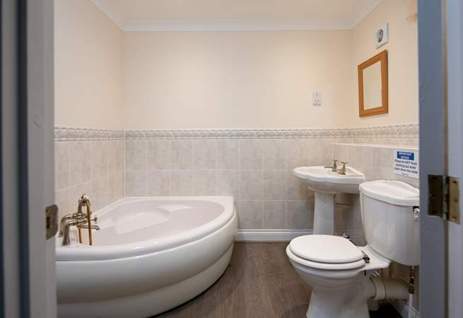 En suite to master bedroom. Comprises of a bath and a shower cubicle.