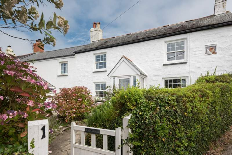 End Cottage is a delightful semi-detached cottage overlooking the village green.