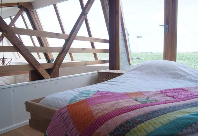 The galleried bedroom on the first floor has a 4' single bed and spectacular countryside views.