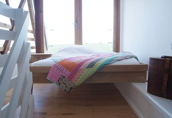 The galleried bedroom has a bespoke bed which can be put away.