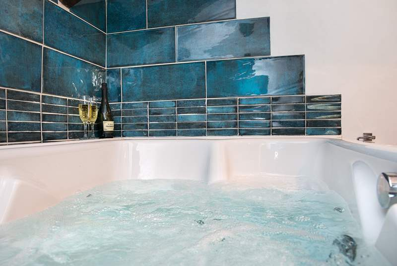 The bathroom has a fabulous double spa bath so you can indulge in bubbles of both kinds!