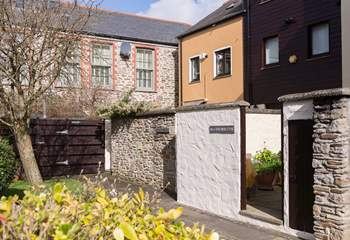 High walls give the rear courtyard ample privacy.