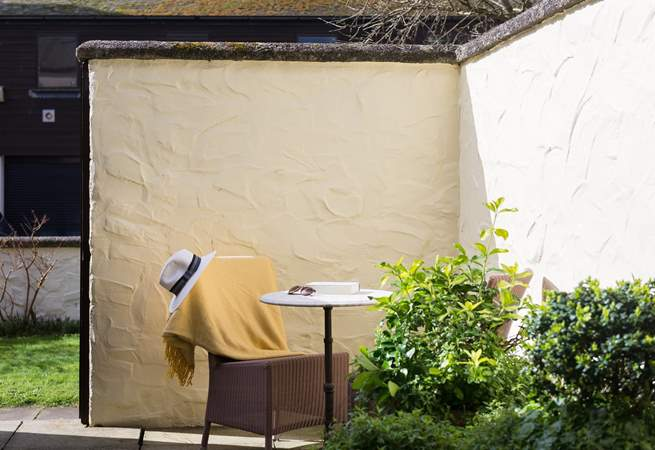 A quiet sheltered corner for relaxing with a book.