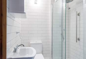 A large shower cubicle with a rainfall shower head.