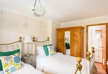 The twin bedroom on the ground floor has an en suite shower-room.