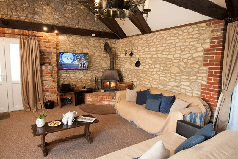 The open plan living-space is great for entertaining. Or snuggle up on the sofa in front of the log-burner.