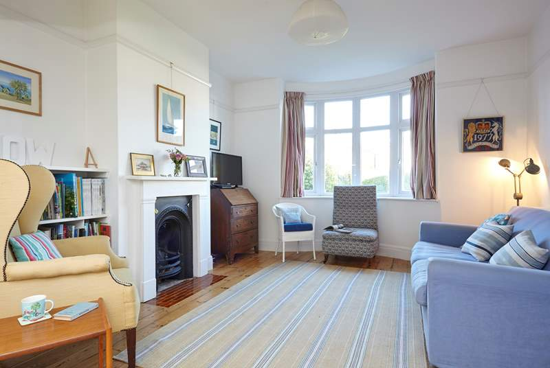 The main sitting-room is very comfortable, perfect for relaxing and snuggling on the sofa