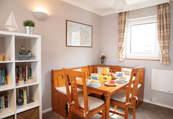 The comfortable living-room, leads on to a bright dining-area.