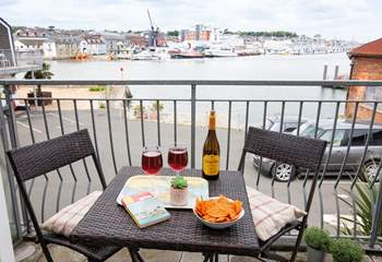 Enjoy watching the busy boat traffic from your private balcony.