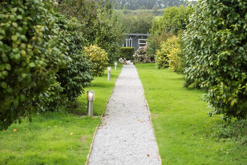 Cuddle Cabin is set at the end of a tree-lined pathway within the owners' smallholding - a perfect romatic retreat.