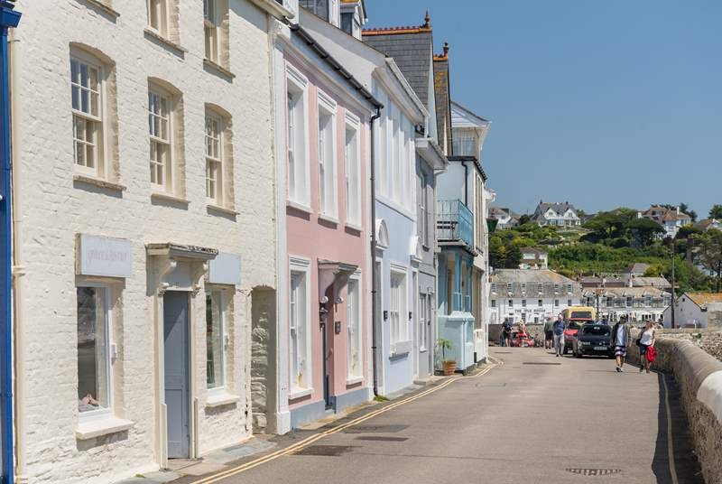 Pretty pastel-painted cottages line the seafront in St Mawes.