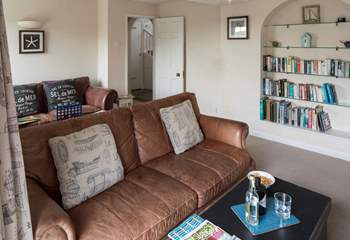The sitting-room runs almost the whole length of the house.
