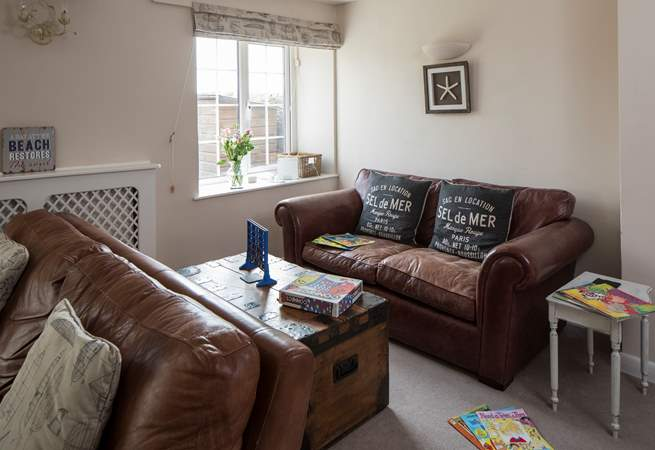 Two large sofas fill this end of the sitting-room, plently of space for reading and games.