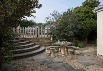 Private parking for two cars is at the back of The Guardhouse, with steps leading down into the rear patio-area.