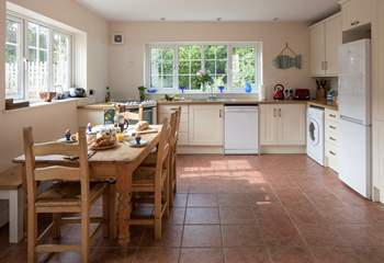 The spacious kitchen is very well-equipped, the window looks out towards Langdon Woods.