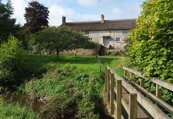 As well as the gardens around the farmhouse there is a small meadow and a little bridge over the river (please supervise children at all times).