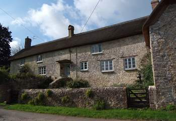 The farmhouse has an enclosed front garden and plenty of parking either to the side of the little no through lane or in the driveway to the side of the house.