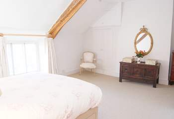 There are some lovely pieces of antique furniture that add to the character of this happy family holiday home.