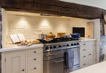 There is a superb range cooker in the original inglenook fireplace.