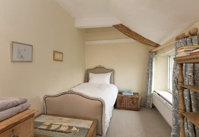 This lovely single bedroom looks out to the front of the farmhouse. The family bathroom is across the corridor.