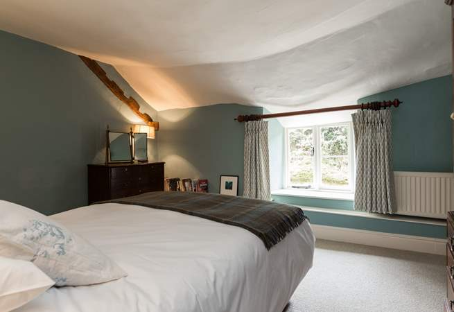 This bedroom looks out to the back of the farmhouse.