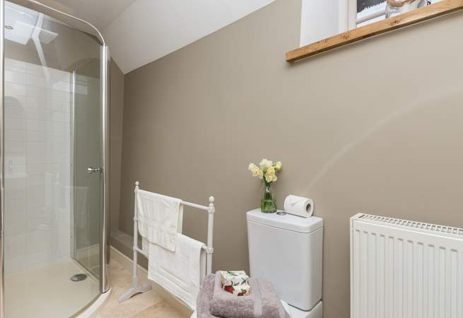 The shower-room is shared by the blue double bedroom and the lower ground floor bedroom.