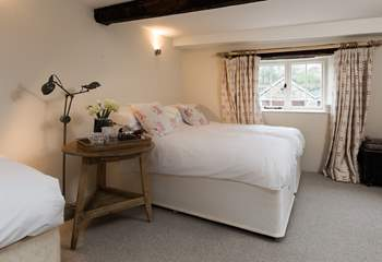 This is the lower ground floor bedroom. This room sleeps 3 guests in 3 single beds, two of which can be pushed together to create the effect of a  double as in this picture. They are not 'zip and link'.
