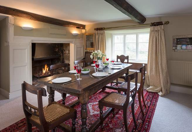 There is a 'formal' dining-room in one of the panelled reception rooms, complete with a huge inglenook fireplace and open fire.